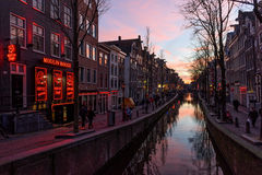 Red light district in Amsterdam at sunset Royalty Free Stock Photo