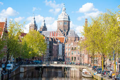 Red light district, the Church of St. Nicholas is visible in the background, the Netherlands. Royalty Free Stock Photography