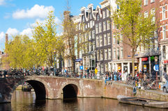 Red light district, crowd of tourists enjoy sightseeing, the Netherlands. Stock Photo