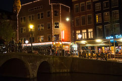 Red-light district at night in Amsterdam, the Netherlands. Royalty Free Stock Photo