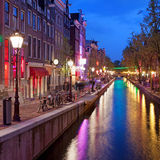 Red Light District in the Old Town of Amsterdam. Red Light District in Amsterdam at night, North Holland, the Netherlands Royalty Free Stock Photos