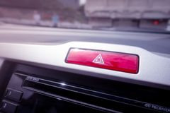 Red light emergency button on a car console. Red light hazard emergency button on a car console stock image