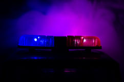 Red light flasher atop of a police car. City lights on the background. Police government concept. Red light flasher atop of a police car. City lights on the Stock Images