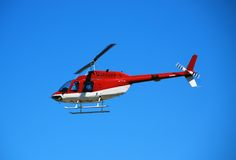 Red light helicopter in flight Stock Photo
