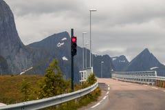 Red light at a narrow bridge. Waiting at red lights to drive over a narrow bridge Stock Photo