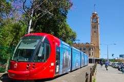 Free Red Light Rail Running On The Track At Pitt St. With Iconic Central Railway Station Clock Tower At The Background. Royalty Free Stock Photos - 123445738