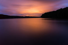 Red light reflex on a lake in a spectacular sunset. In the baltic sea Royalty Free Stock Photo