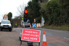 Red light sign at road works Stock Photo