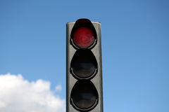 Red light-signal of traffic light. Photo closeup traffic light semaphore with red light-signal stop sign indicator signaling device day time against blue sky royalty free stock images