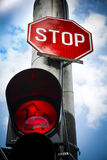 Red light stop sign at road junction Stock Photos