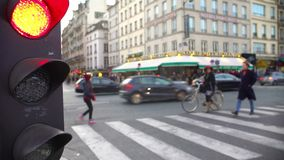 Red light for street traffic, pedestrians crossing road, active city life. Stock footage stock video