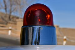 Classic bright red light on a police car. The red light on top of a police car of the 1960`s Royalty Free Stock Images