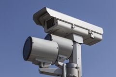 Red Light Traffic Camera. With mounted strobe lights Royalty Free Stock Photography