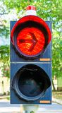 Red light at a traffic light with an arrow prohibiting vehicles wishing to turn right from continuing their journey stock photo