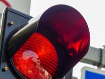 Red light at a traffic light. At a traffic light, the red light is lit. symbolic photo for holding stock images