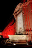 A red light for the Vanvitelli fountain in the night. Civitavecchia Rome Italy A special light game of intense red color that beautifies Vanvitelli`s fountain in Royalty Free Stock Images