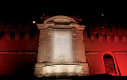 A red light for the Vanvitelli fountain in the night. Civitavecchia Rome Italy A special light game of intense red color that beautifies Vanvitelli`s fountain in Stock Image