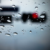 Red light through window in raining day Royalty Free Stock Photography