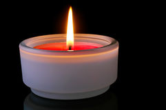 Red lighted candle Stock Photography