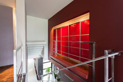 Red lighted wall in modern house Royalty Free Stock Photography