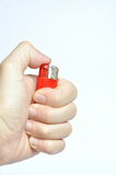 Red lighter in hand Stock Photos