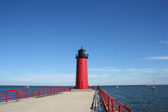 Red Lighthouse. A red Lighthouse at the end of a pier Stock Photography