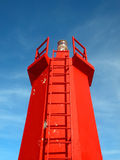 Red lighthouse. Contrasting with blue sky Royalty Free Stock Photo