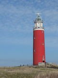 Red lighthouse against a blue sky. Red lighthouse on the Island of Texel in The Netherlands. Blue sky in the background Royalty Free Stock Photo