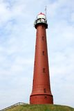 Red lighthouse along the dutch coast, IJmuiden Royalty Free Stock Photo