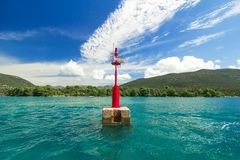 Red lighthouse on the background of the blue Sea, sunny day Royalty Free Stock Photography