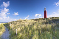 A red lighthouse at the beach in the dunes Stock Images