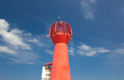 Red lighthouse in a blue sky Royalty Free Stock Image