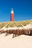 Red lighthouse at the coast Stock Images