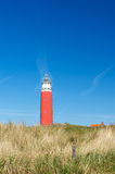 Red lighthouse at the coast Royalty Free Stock Photos