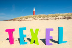 Red lighthouse at the coast from Texel Stock Photography