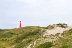 Red lighthouse in the dunes Royalty Free Stock Image