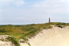 Red lighthouse in the dunes Royalty Free Stock Photography