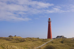 Red Lighthouse in Dunes at Schiermonnikoog Stock Photography