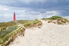 Red lighthouse and dunes Royalty Free Stock Photos