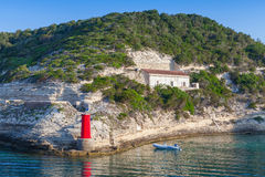 Red lighthouse, entrance to the port of Bonifacio Royalty Free Stock Photography