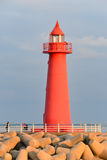 Red Lighthouse in the evening sun Stock Images