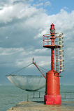 Red lighthouse and fishing net Royalty Free Stock Images