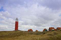 Red lighthouse and houses Royalty Free Stock Photography