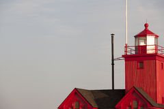 A red lighthouse. Image of a peaked red lighthouse Royalty Free Stock Photos