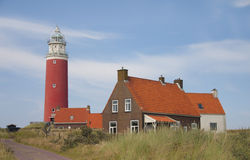 Red lighthouse, little houses on Texel Royalty Free Stock Photography