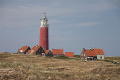 Red lighthouse, little houses on Texel Stock Photography