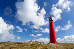 Red lighthouse oer blue sky Stock Images