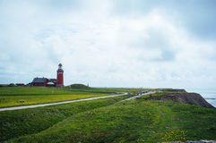 Red lighthouse in a picturesque landscape stock image