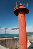 Red lighthouse pole above blue sky Stock Photo