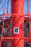 Red Lighthouse Tower. A window in the cylindrical core of an unusual iron lighthouse painted in brilliant red. Port Adelaide, South Australia Stock Photos